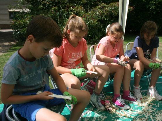Four children enjoying a craft activity
